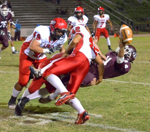 Lahainaluna's Jared Purdy and Gabriel Montano (behind 42) force this fumble from Baldwin kick returner Dusty Flores (43) as Lunas' Jonathan Lolohea (48) looks on. Photo by Rodney S. Yap.