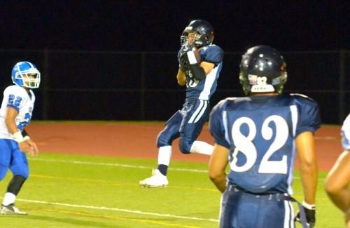 Kamehameha Maui's Joshua Hiwatashi catches this 34-yard touchdown pass in the third quarter. Photo by Rodney S. Yap.
