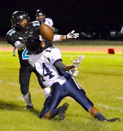 King Kekaulike's Jacob Ramos (22) breaks up this pass intended for Kamehameha Maui's Keoni Keanini (14) in the second half. Photo by Rodney S. Yap.