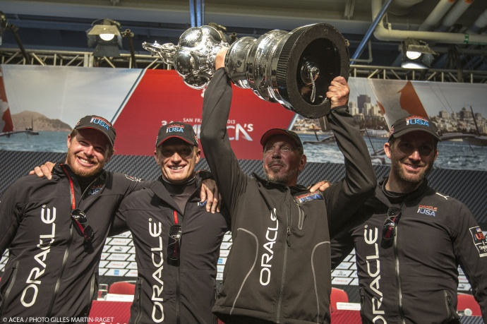 Larry Ellison, surrounded by members of Team Oracle USA,  hoists the trophy after taking top honors at the America's Cup. Sept. 25, 2013 - San Francisco (USA,CA) - 34th America's Cup - Final Match - Racing Day 15. Photo by ACEA/Photo Gilles Martin-Raget, courtesy America's Cup with express permission.