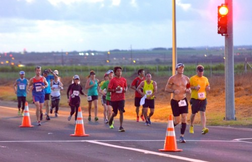More marathon runners make their way to Kaanapali early this morning on Highway 30 near The Dunes at Maui Lani Golf Course. Photo by Rodney S. Yap.