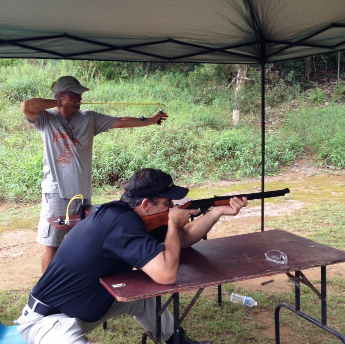 Barry Aoki on slingshot and Allan Brown on Air Rifle/BB Gun from the SHOPO Team compete in the Boy Scouts' inaugural Sportsman Challenge. Courtesy photo.