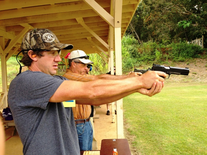 Kelly O'Keefe and Ray Skelton compete in the pistol range from the Goodfellow Brothers team took home 3rd place in the Boy Scouts' Sportsman Challenge. Courtesy photo.