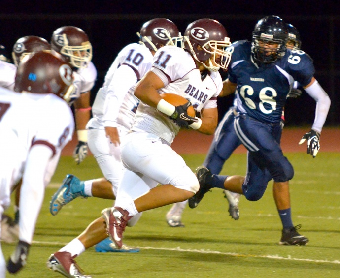 Baldwin's Nohea Keahi returns the first of his two interceptions Friday at Kamehameha Maui. Photo by Rodney S. Yap.