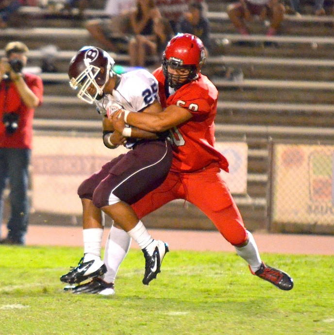Lahainaluna defensive end Hercules Mata'afa wraps up Baldwin running back Keenan Lewis  in the second quarter Friday. Photo by Rodney S. Yap.