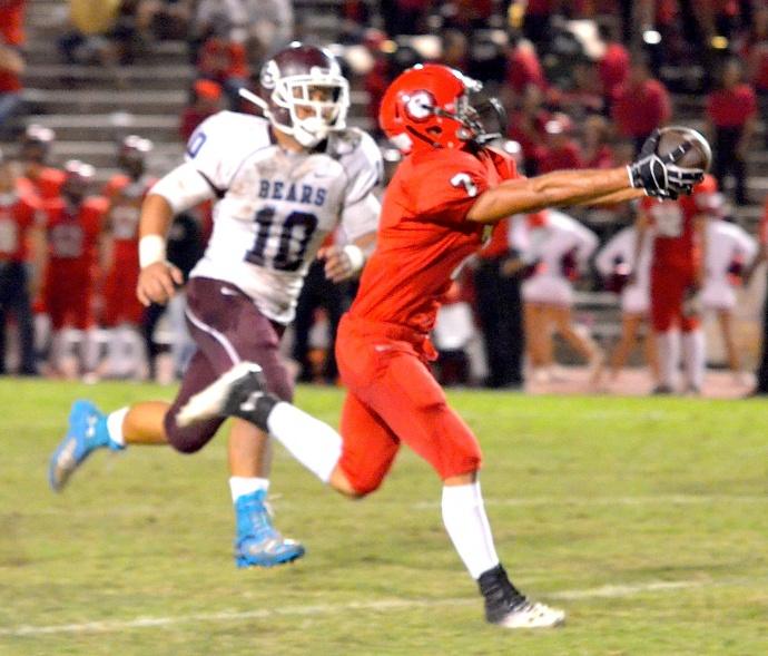 Lahainaluna's Jeffery Ancog reaches out to grab this 58-yard touchdown pass from quarterback Makoa Filikitonga on the last play of the first half Friday against Baldwin.  Photo by Rodney S. Yap.