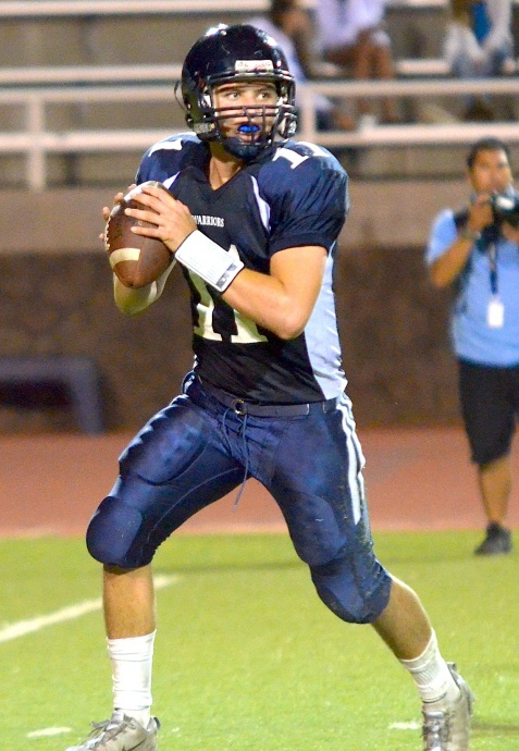 KS-Maui quarterback Chase Newton looks for his receivers down field. Photo by Rodney S. Yap.