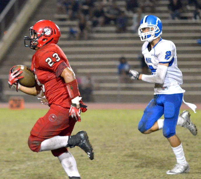 Lahainaluna's Jared Rocha-Islas (23) breaks open a big run against Maui High and Andre Pierman (8) last Saturday. Rocha-Islas won the 2013 MIL rushing and scoring titles. Photo by Rodney S. Yap.