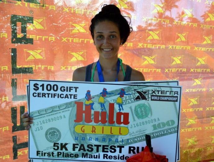 Dakota Grossman holds up her gift certificate for winning the women's 5K. Photo courtesy of XTERRA photos.