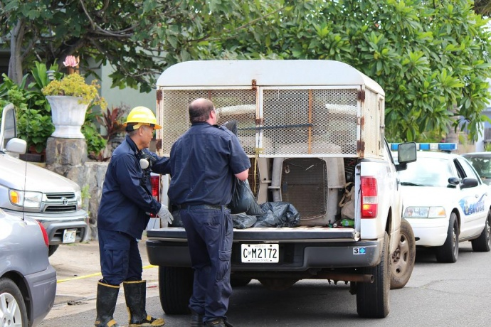 At around 11:30 a.m., fire and police investigators remained on scene.  Police were seen loading several bags into the back of an animal rescue truck.  Photo by Wendy Osher.