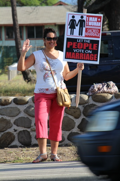 Supporters of traditional marriage between individuals of the opposite sex were among those holding signs along Kaʻahumanu Avenue in the days leading up to the special session on Marriage Equity, set to start on Oct. 28.  Photo by Wendy Osher.