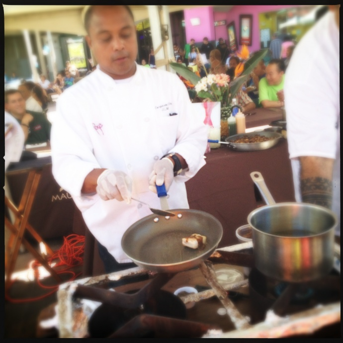 Chef Macadangdang prepares his winning dish last year. Photo by Vanessa Wolf
