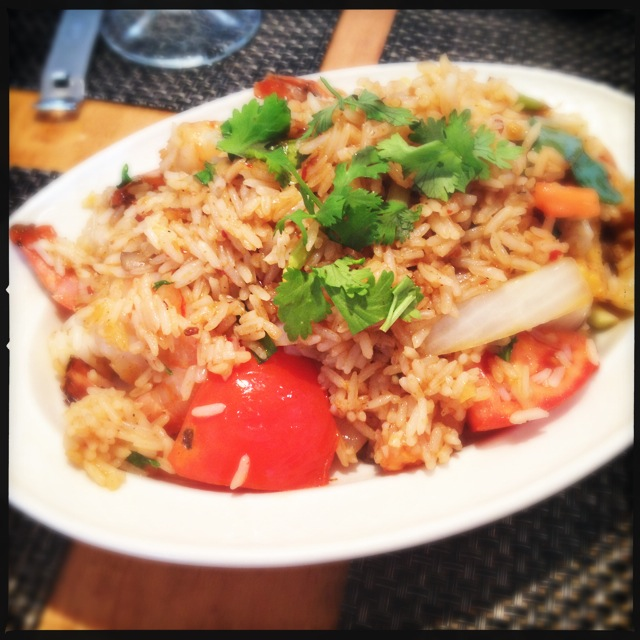 The Tom Yum Fried Rice contains some unexpected objects. Photo by Vanessa Wolf