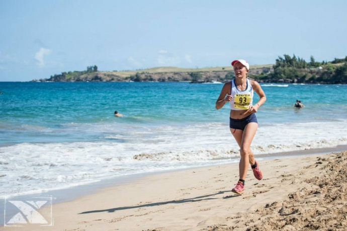 Emilie Menuet placed 14th overall and took the women's 10K title in her first try at the Kapalua course. Photo courtesy of XTERRA photos.