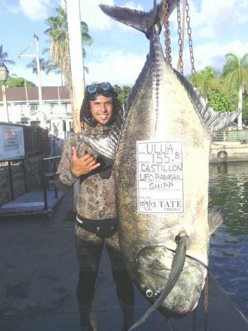 Haiku's Travis Castillon with his record-breaking ulua at Lahaina Harbor Wednesday. Photo courtesy of Travis Castillon.