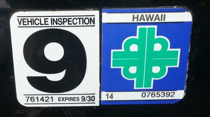 The state is proposing to upgrade Hawai`i's current vehicle safety sticker, shown above, in favor of a one-piece sticker printed out at the inspection station. Photo by Dave Smith.