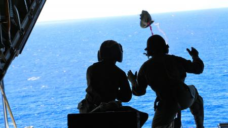 A Coast Guard aircrew from Air Station Barbers Point flew approximately 1,036 miles to airdrop a container of lifesaving blood to a cruise ship northeast of the Hawaiian islands Oct. 6, 2013. Personnel aboard the cruise ship Oosterdam contacted the Coast Guard requesting medical assistance for an ailing passenger. (US Coast Guard photo)