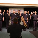 Maui Police Department's 78th Graduating Recruit Class takes an oath at the Maui Beach Hotel's Elleair Ballroom.  Photo courtesy County of Maui.
