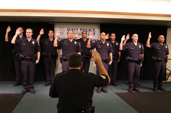 Maui Police Department's 78th Graduating Recruit Class takes an oath at the Maui Beach Hotel's Elleair Ballroom.  Photo courtesy County of Maui.