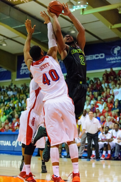 Baylor's Rico Gathers goes up hard to the glass against Dayton's defense Tuesday at the Lahaina Civic Center. Photo by Denton Johnson.