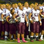 The Farrington High School football team sings the school's alma mater prior to kickoff last Friday, Nov. 8, at War Memorial Stadium. Photo by Rodney S. Yap.