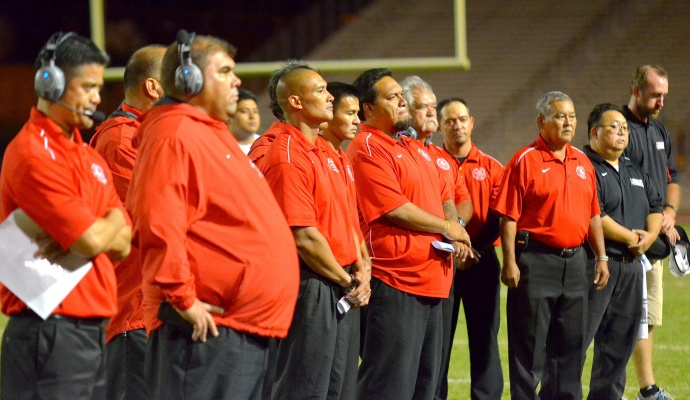 The Lahainaluna High School coaching staff during the school's alma mater earlier this year. File photo by Rodney S. Yap.