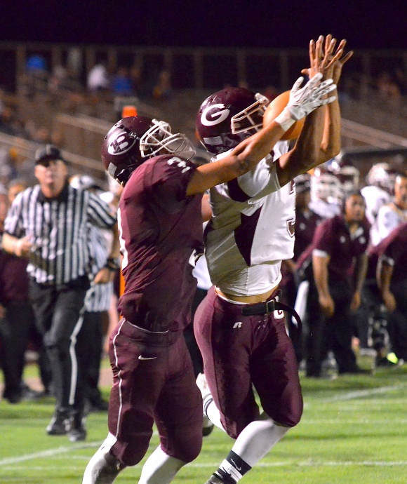 Farrington's Roger Boyd intercepts this pass intended for Baldwin's Jeremiah Badillo (3) late in the fourth quarter Friday at War Memorial Stadium. Farrington beat Baldwin 21-3. Photo by Rodney S. Yap.