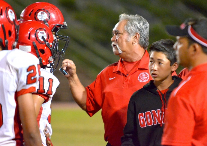 Lahainaluna co-head coach Bobby Watson talks to players during a defensive timeout earlier this year. File photo by Rodney S. Yap.