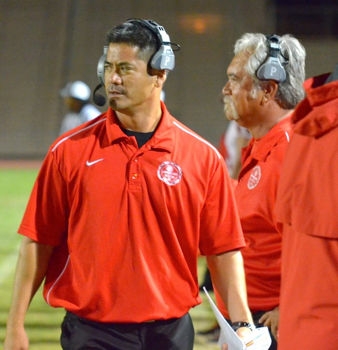Lahainaluna High School offensive coordinator and co-head coach Garret Tihada is flanked by defensive coordinator and co-head coach Bobby Watson against Baldwin in the first round earlier this year. File photo by Rodney S. Yap.