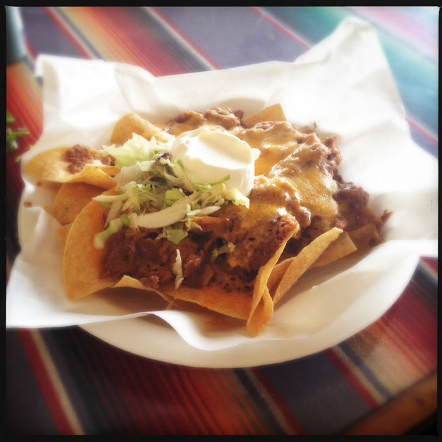 Seriously. There is a solid 16 ounces of beans on this plate of Nachos. Photo by Vanessa Wolf