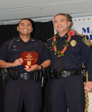 Chief Gary YABUTA presenting the Outstanding Recruit Award to Officer Christopher Visaya. Photo courtesy Maui Police.