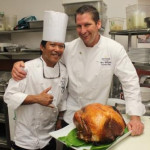 Makena Resort's Executive Chef Marc McDowell and Executive Sous Chef Steve Avergonzado prepare their signature Sage and Thyme Brine Roasted Whole Tom Turkey.