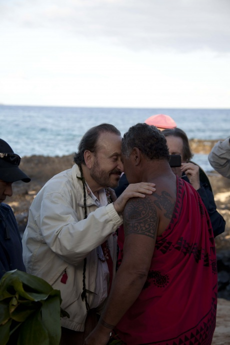 """Filming of the Lifetime Channel movie, """"The Blue Lagoon,"""" took place on Maui in 2012.  The OED hopes to bring more productions to Maui through the Film Office.  Photo: Director Mikael Salomon receives a blessing from Kimokeo Kapahulehua before the filming began. Image courtesy County of Maui."""