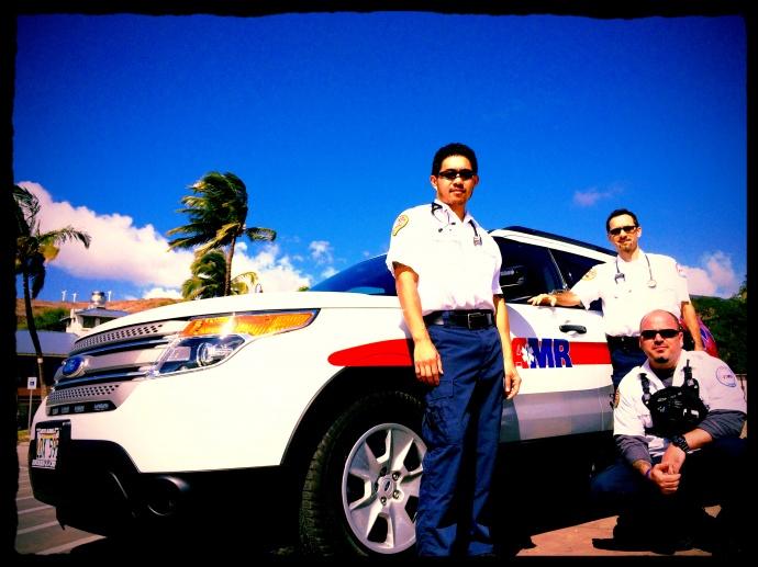AMR Rapid Response Unit Paramedics. Danh Richardson (L), David Kingdon (R) and Kapena Hill (lower right). Courtesy photo.