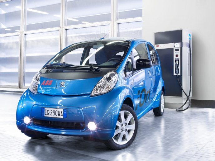 The Terra 51 Charge Station by an electric vehicle. Photo courtesy ABB.