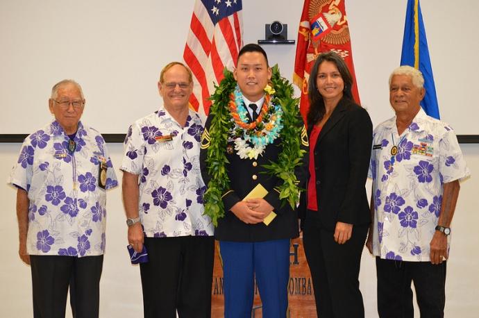 Congresswoman Tulsi Gabbard presented the Purple Heart to SFC Takumi Abe. Photo courtesy Rep. Gabbard.