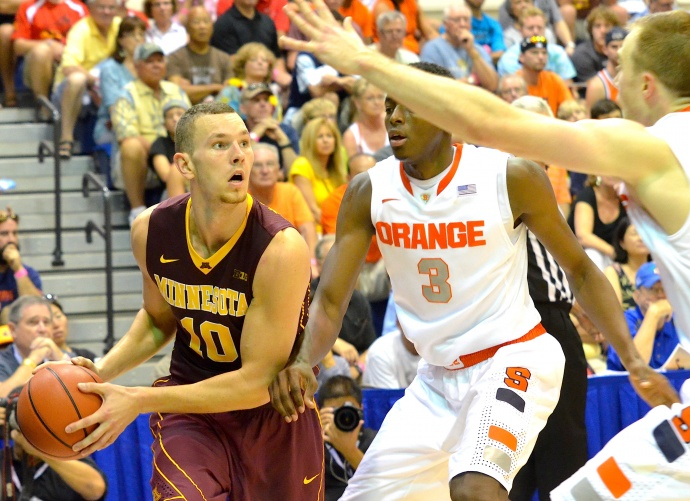 Minnesota's Oto Osenieks (10) looks for an open man as Syracuse's Jerami Grant applies defensive pressure. Photo by Rodney S. Yap.