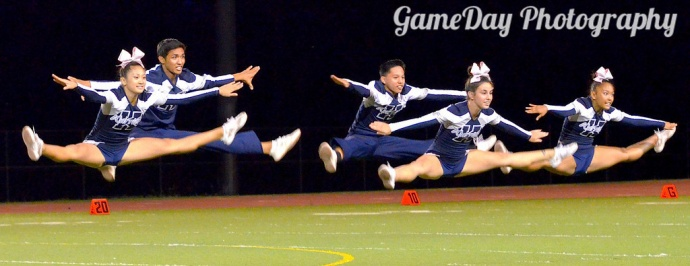 The Kamehameha Schools Maui cheerleaders in action during halftime of a varsity football game at the Warriors' campus earlier this year. Photo courtesy of GameDay Photography.