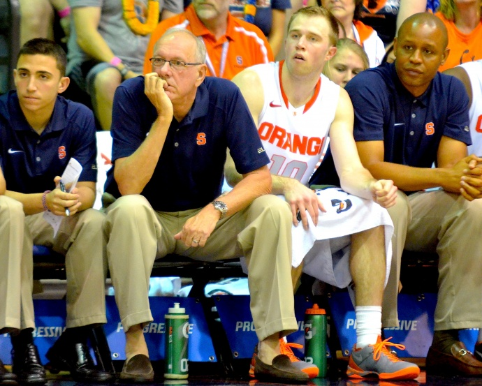 Syracuse head coach Jim Boeheim on the bench with Trevor Cooney and Orange assistant coaches. Photo by Rodney S. Yap.