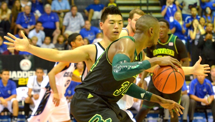 Chaminade's Kevin Hu guards Baylor's Cory Jefferson during Monday's opening round of the Maui Invitational Tournament at the Lahaina Civic Center. Photo by Rodney S. Yap.