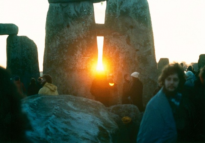 This is an image of sunrise at Stonehenge during a winter solstice in the 80s courtesy of Wikipedia, but also looks like it should be a Bob Dylan album cover.