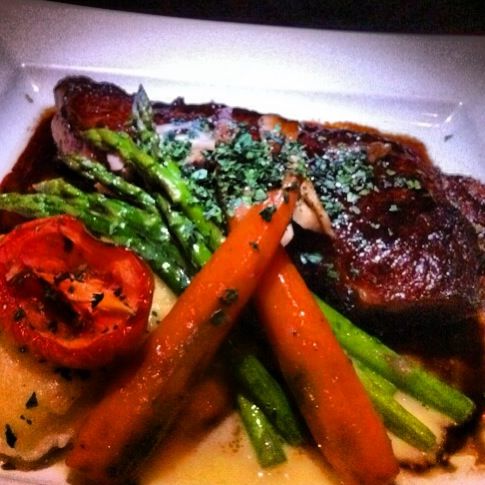 The NY Steak and those inexplicably tasty carrots. Photo by Vanessa Wolf