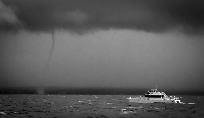 Water Spout seen off shore from McGegor Point: Photo by Captain Drew Sulock of the Pacific Whale Foundation, Maui.