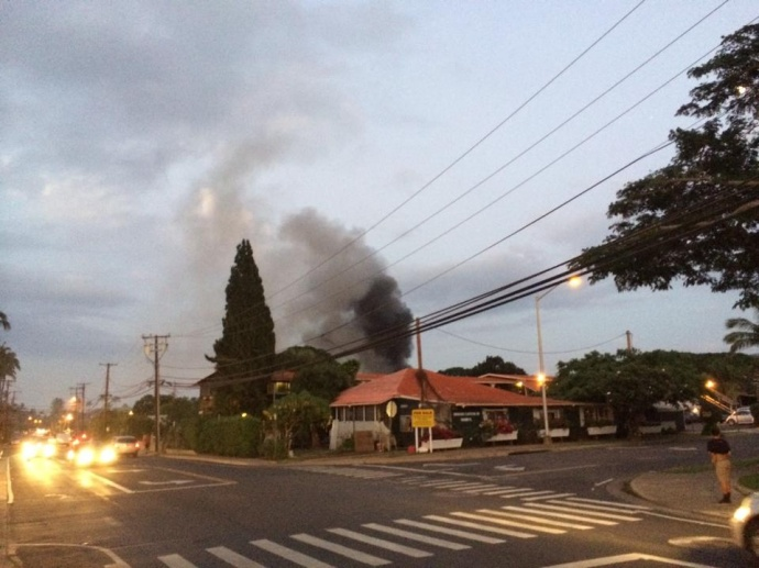 This photo was taken from the ABC Store on Lower Honoapiʻilani Road across the street from the Sunset Terrace apartments where smoke could be seen coming from the complex. Photo courtesy Sam Florez.
