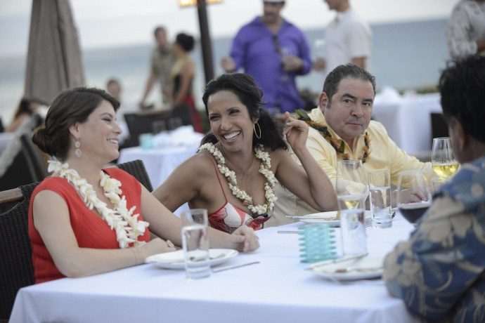 Top Chef judges, from left, Gail Simmons, Padma Laskshmi, and Emeril Lagasse enjoy a moment during filming at Merriman's Kapalua on Maui. Photo credit: Bravo Photo.