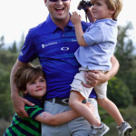 Zach Johnson celebrates with his sons, Will (L) and Wyatt (R), after winning the Hyundai Tournament of Champions at the Plantation Course at Kapalua on Monday, Jan. 6. Photo by Tom Pennington/Getty Images.