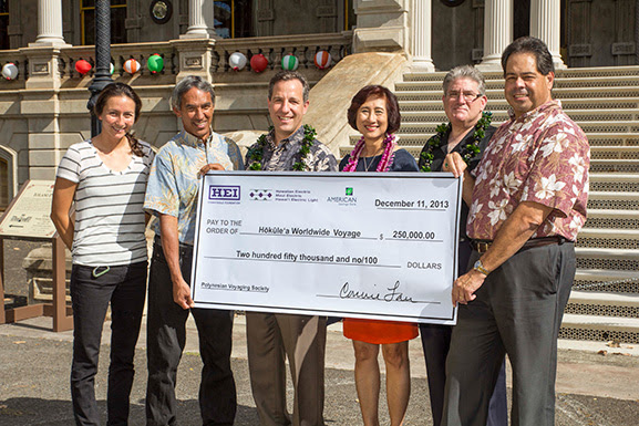 PVS has been awarded a five-year, $250,000 grant from Hawaiian Electric Industries (HEI) to support Hokule'a. Standing left to right are: Jenna Ishii (PVS), Nainoa Thompson (PVS), Rich Wacker (American Savings Bank), Connie Lau (HEI), Dick Rosenblum (Hawaiian Electric) and Clyde Namuo (PVS). Photo credit: 'Oiwi TV.