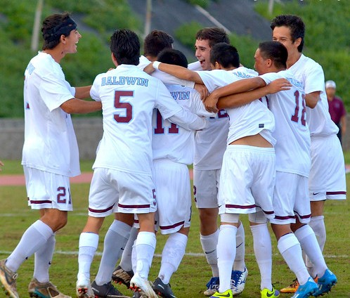 The Baldwin boys soccer team celebrate a goal against King Kekaulike earlier this year. File photo by Rodney S. Yap.