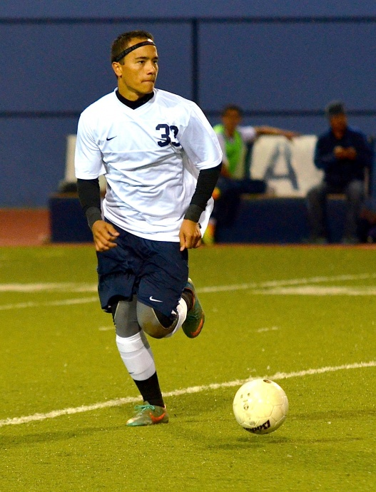 Kamehameha Maui senior midfielder Kailoa Akoi scored the Warriors first goal Wednesday against Mililani in the third minute of the match. File photo by Rodney S. Yap.