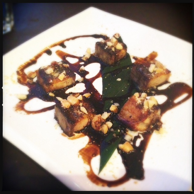 The Braised Pork Belly comes with some heavy-handed balsamic reduction. Photo by Vanessa Wolf